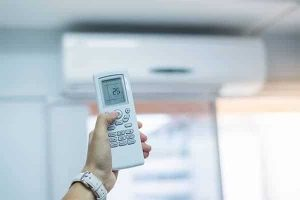 Hand-using-remote-controller-for-adjust-air-conditioner-inside-the-room 600x400